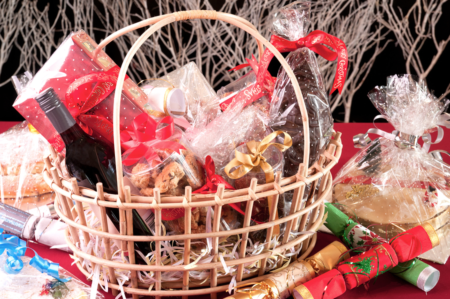 Christmas hamper basket with a chocolate santa, cookies and a bottle of wine ** Note: Visible grain at 100%, best at smaller sizes