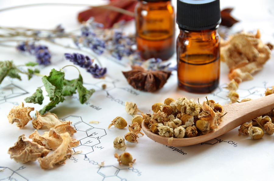 dried herbs and essential oils on science sheet