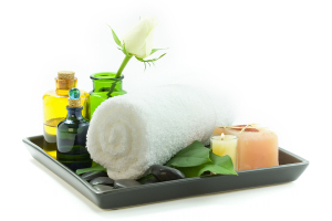 relaxation spa set with candles, essential oils, towel, pebbles