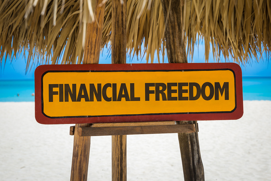 Financial Freedom sign with beach background