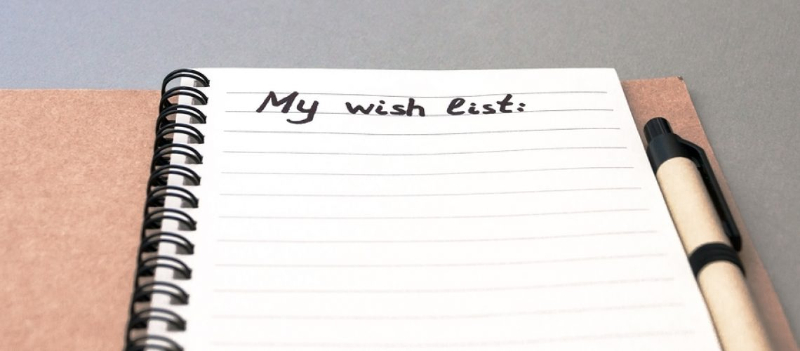 Hand drawing wish list on notebook from recycling paper on grey background with handle