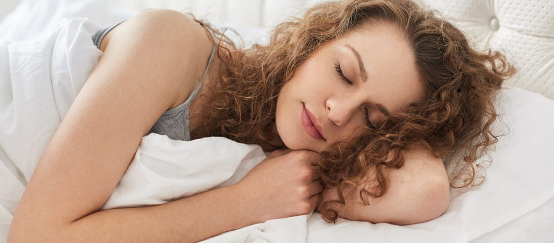 Horizontal Shot Of Pretty Young Woman Sleeps Sweetly At Bed, See